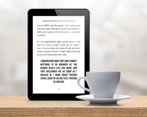 Book text displayed on an iPad in front of a white cup of coffee on a saucer, showing the large print of the book on a mobile device